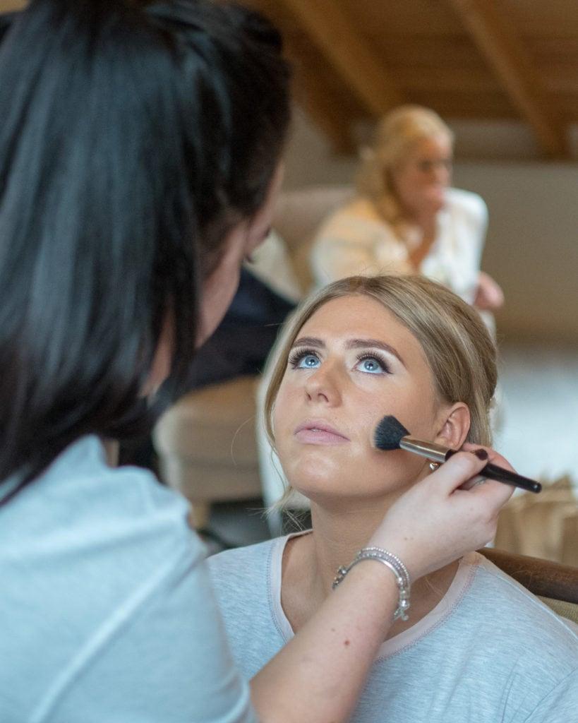 A wedding makeup artist at work