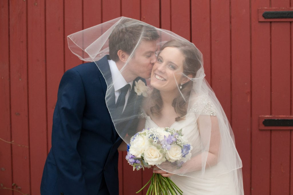 Happy couple under the veil.