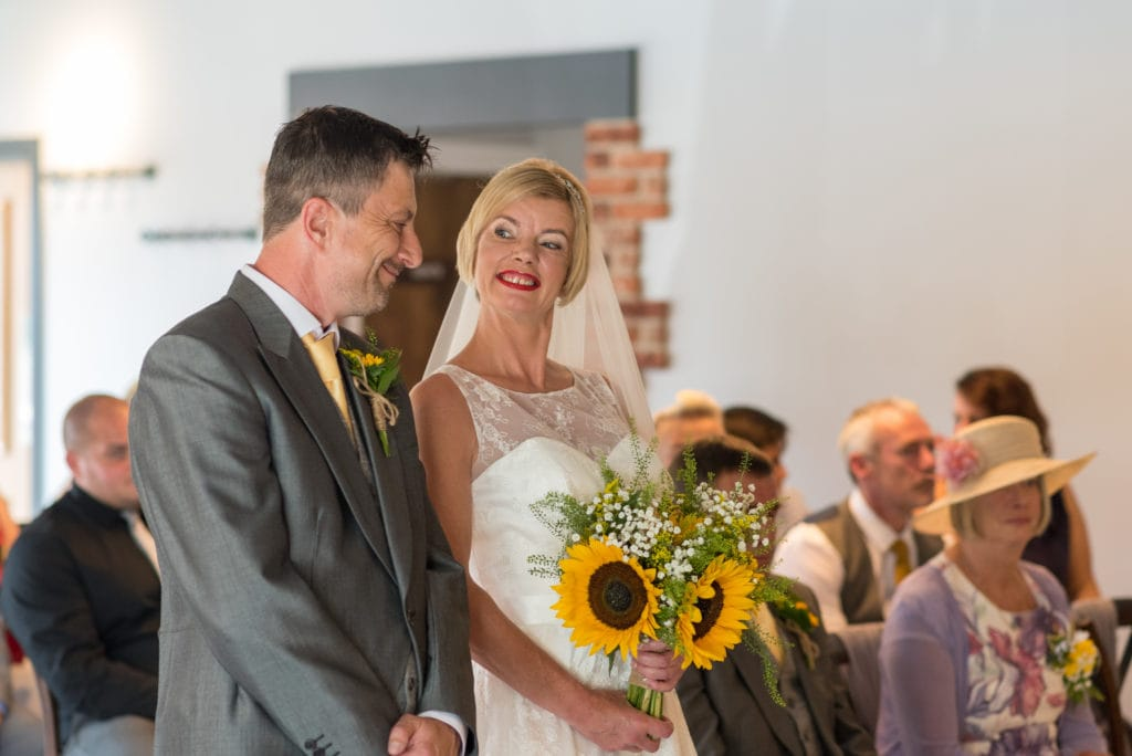 Couple enjoying their wedding with sunflower